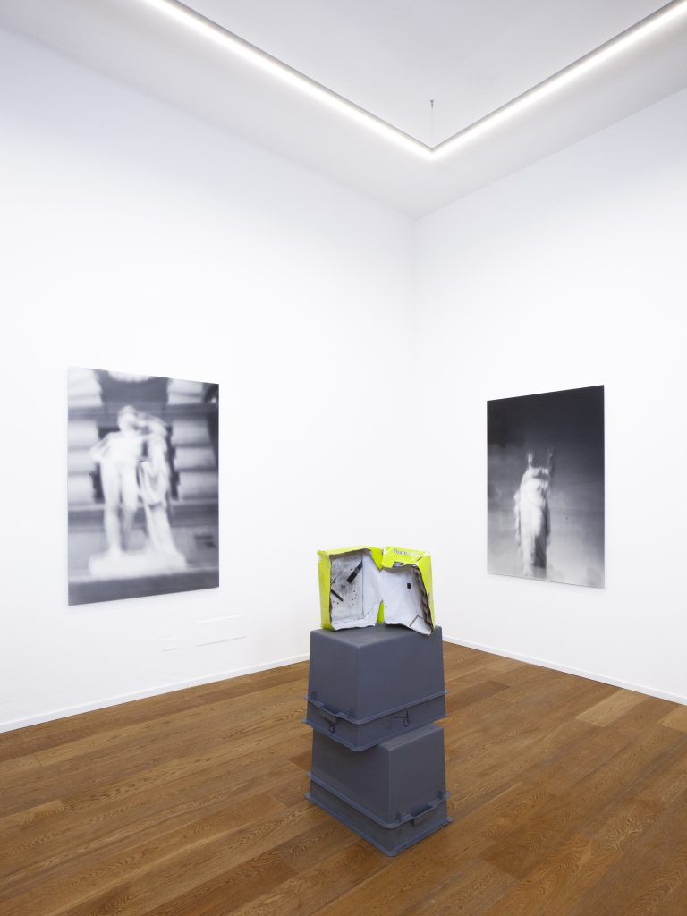 (left) Museum Rules (Paris), 2021; (right) Museum Rules (Temperance), 2021. Black and white gelatin silver prints, 150 x 104.5 cm, edition of 3 each; (floor) Postal Summary, 2021, shipping box, photo emulsion, 36 x23 x 12 cm